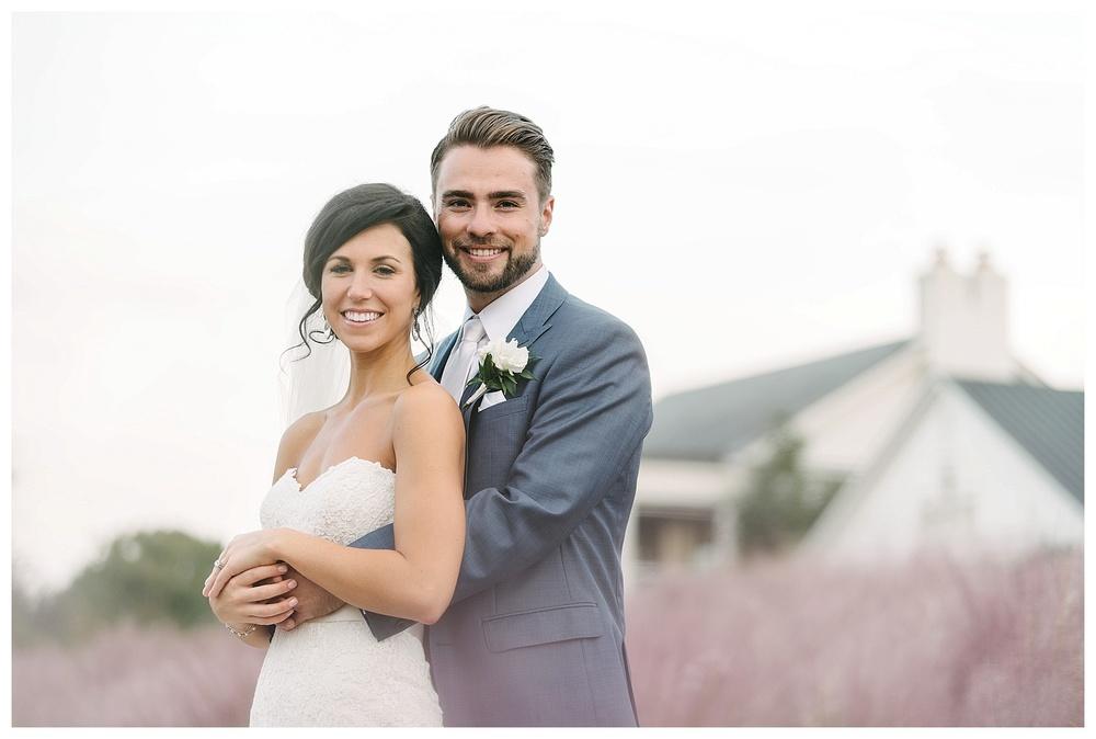bride and groom at daniel island club charleston sc