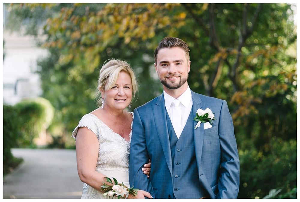 groom poses with mom at daniel island club charleston sc