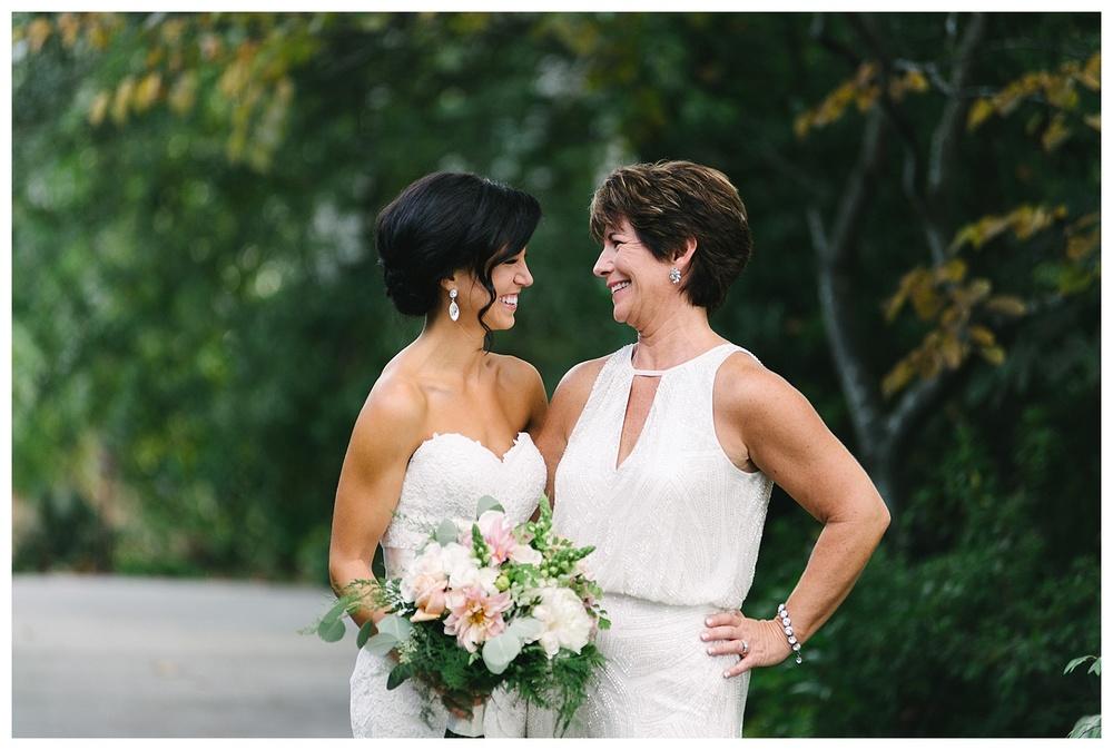mom poses with bride at daniel island club charleston sc