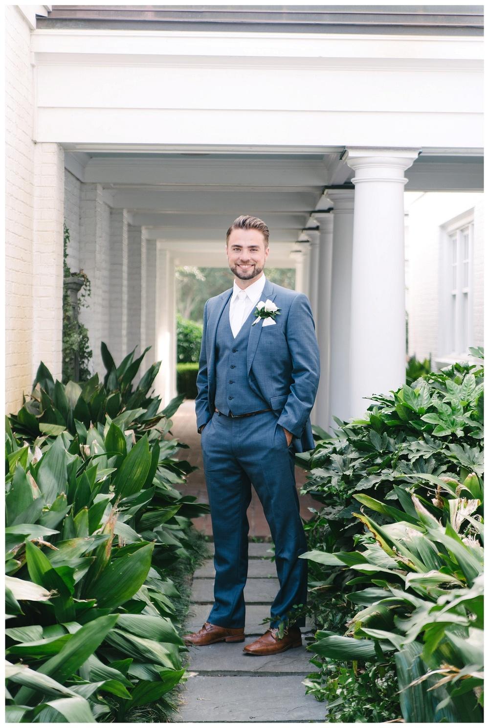 groom poses at daniel island club charleston sc