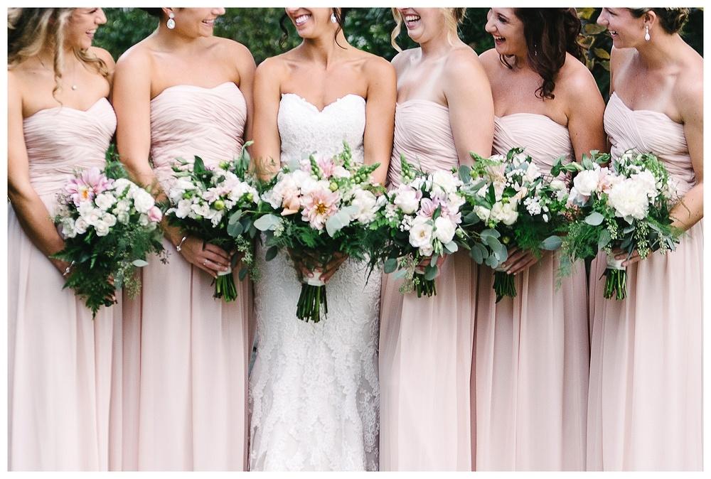 bridesmaids pose with bride at daniel island club charleston sc
