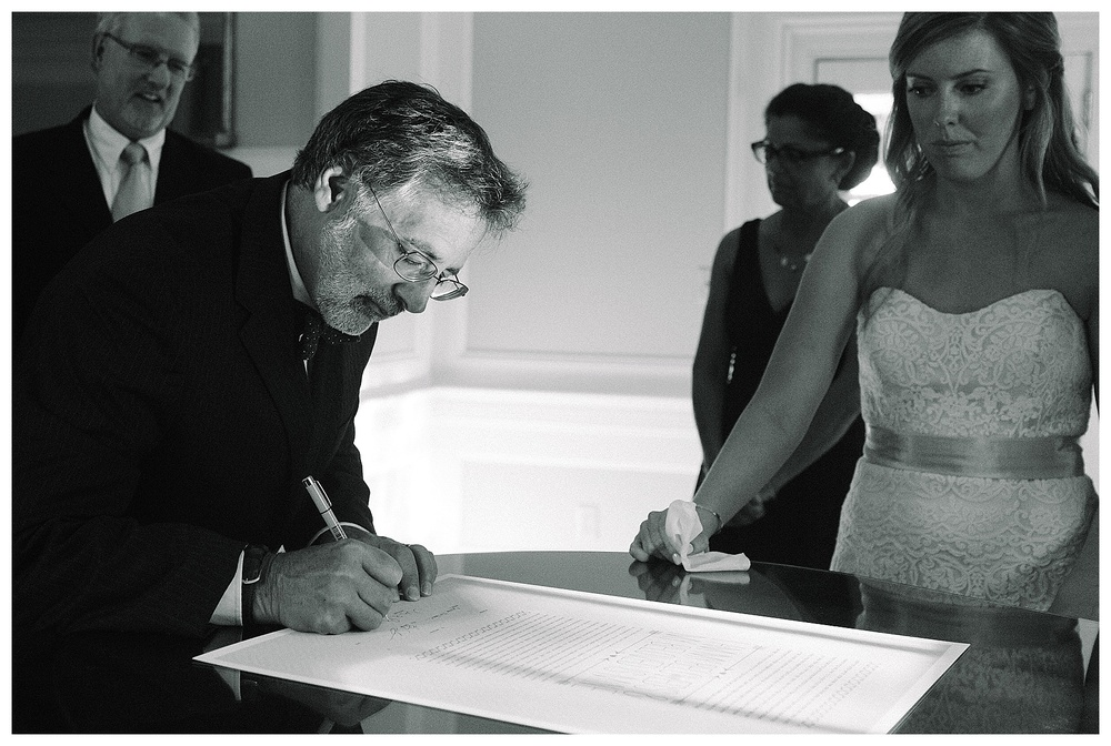 Jewish couple sign ketubah at Legare Warring House wedding venue