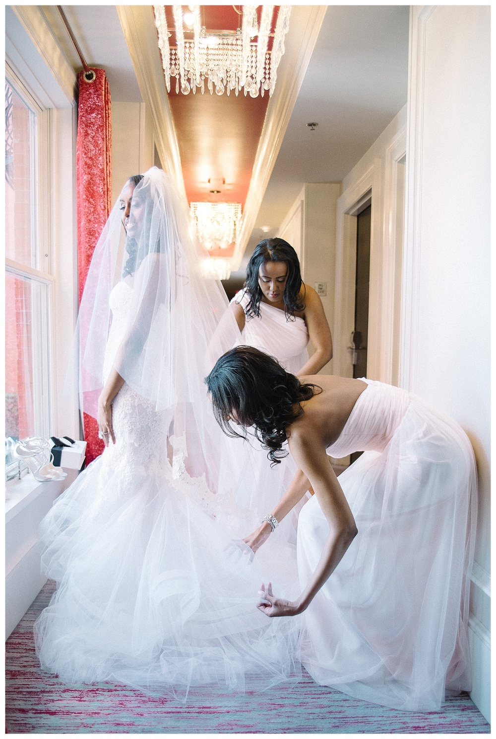 bride gets dressed in her room at Mansion Forsyth