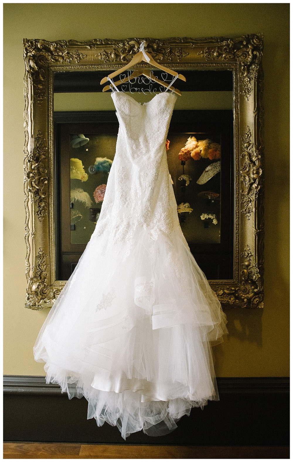 Bride's dress hanging inside Mansion Forsyth Park