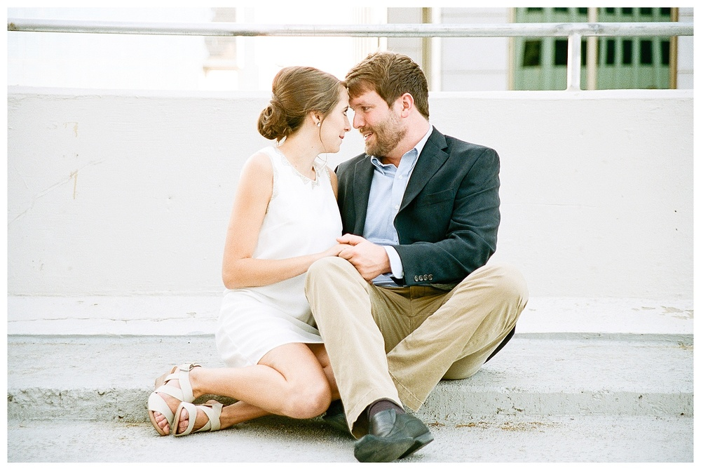 Charlotte engagement session by film wedding photographer - rooftop of parking deck, Charlotte, NC
