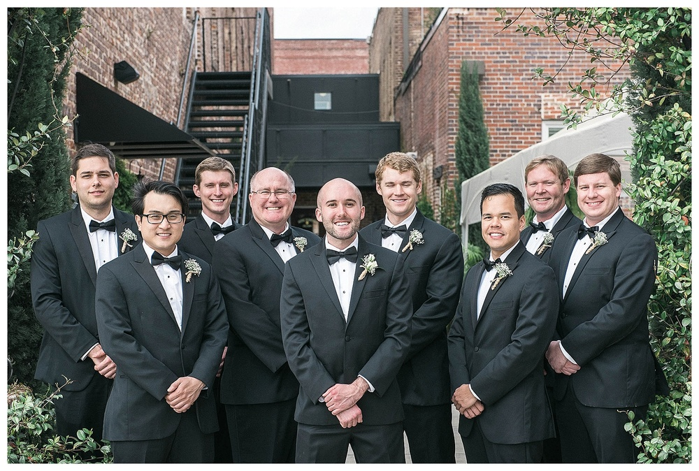 groom and groomsmen pose for wedding photo for wedding at Hotel Florence, SC
