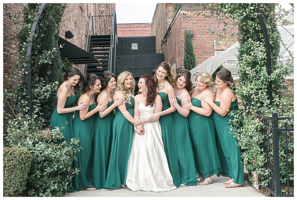 bride and bridesmaids pose for wedding photo for wedding at Hotel Florence, SC