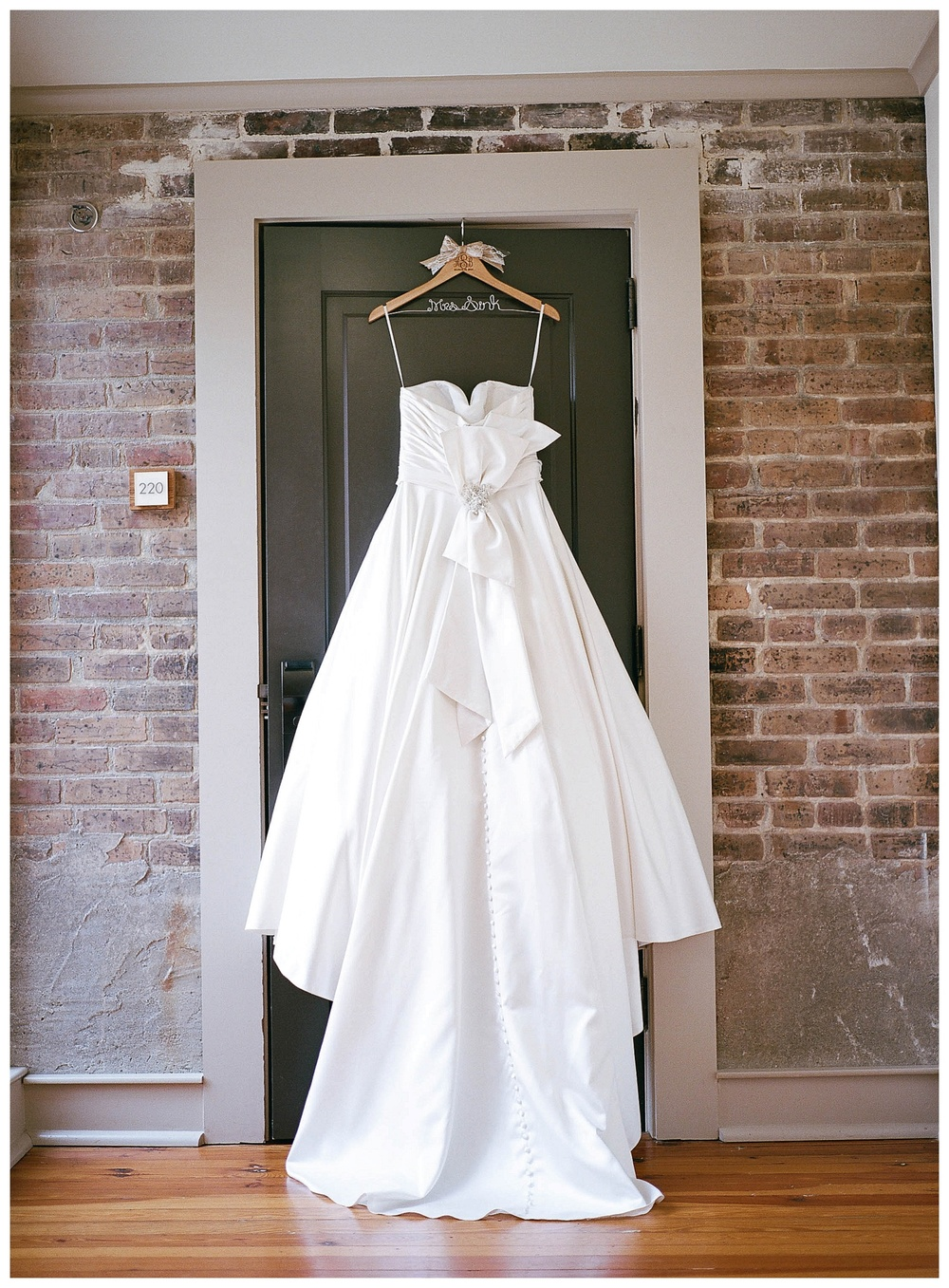Bridal gown hanging on penthouse door, Hotel Florence, SC - wedding at Hotel Florence