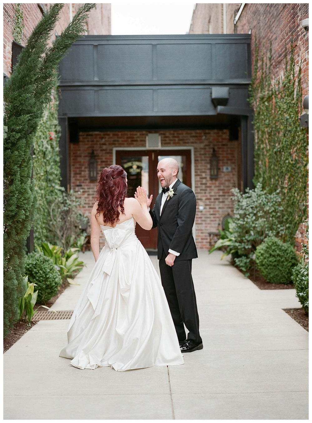 couple high-five in photo for wedding at Hotel Florence, SC