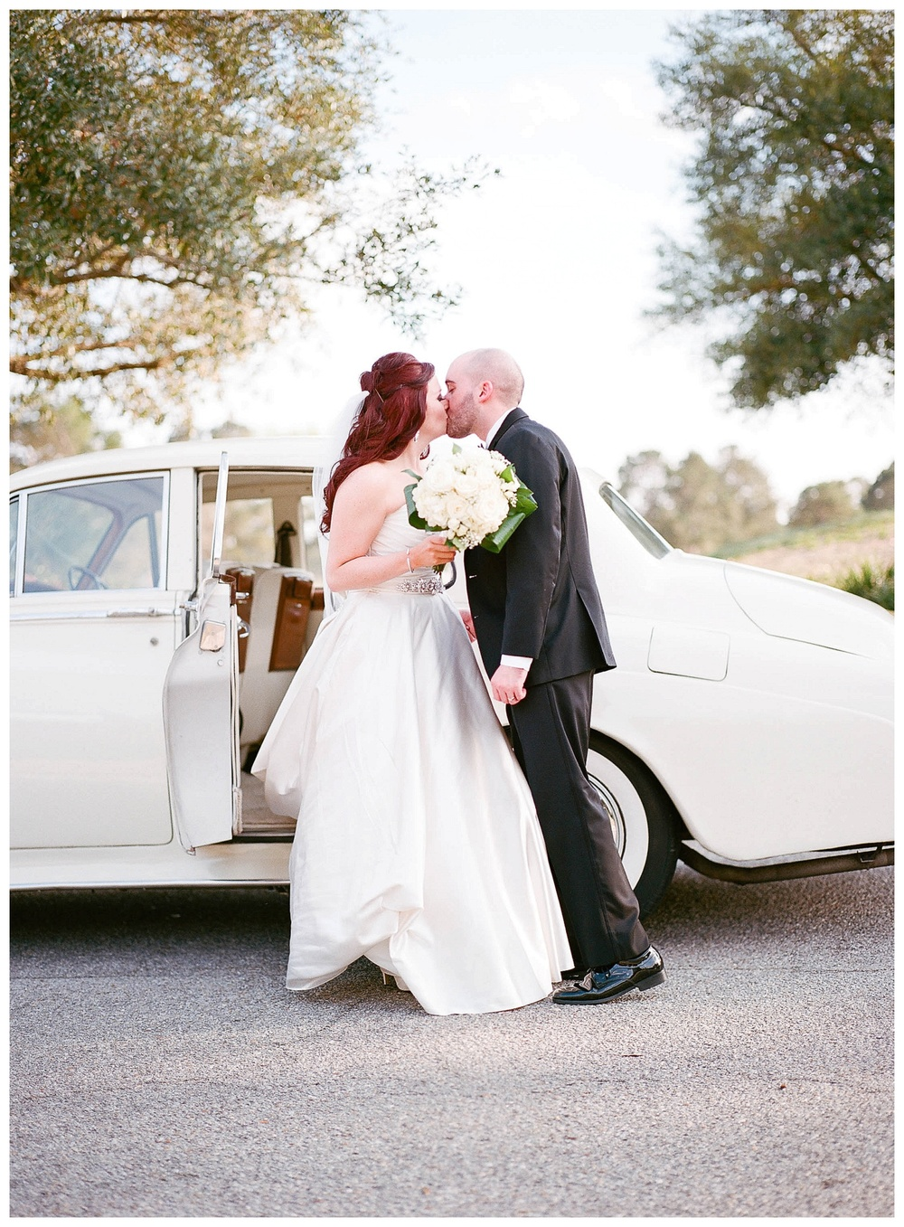 Destination wedding - film wedding photography - couple kissing in rolls royce