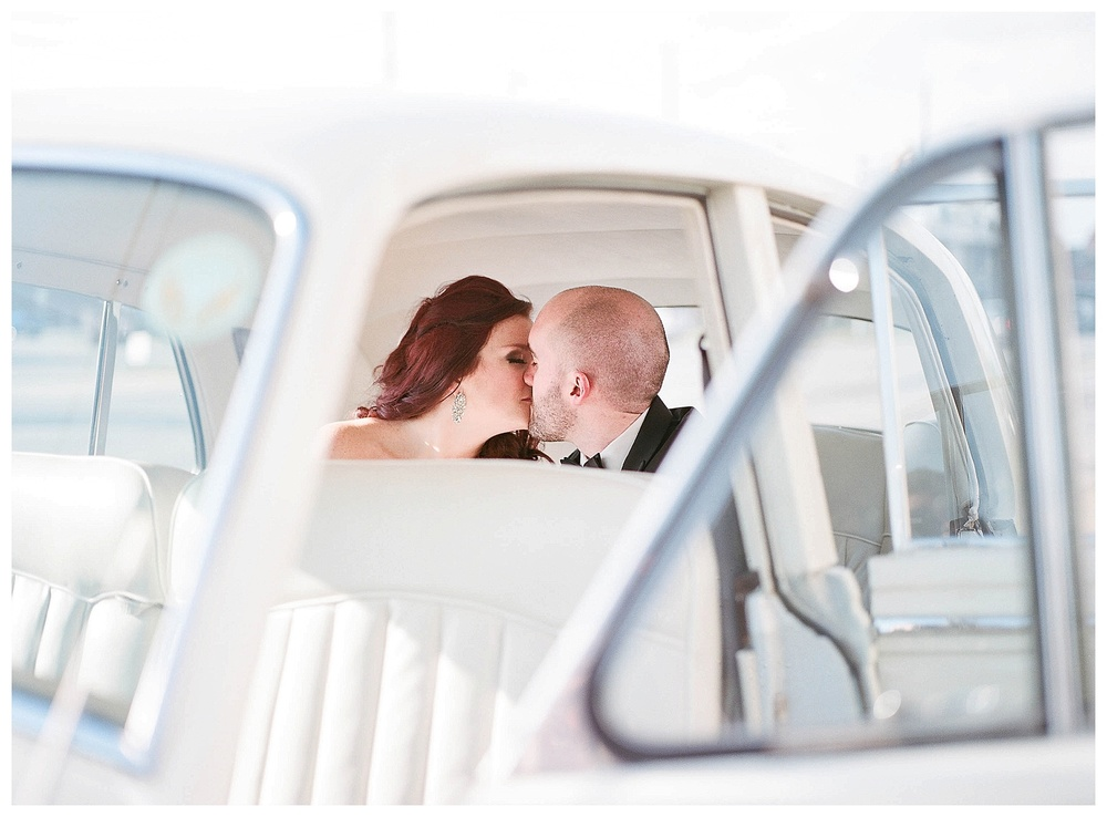 Destination wedding - hybrid wedding photographer - couple kissing in rolls royce