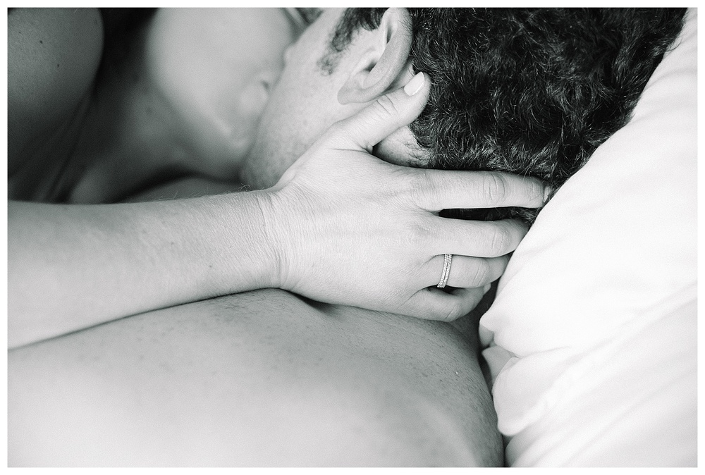 couple's boudoir photography, intimate kiss