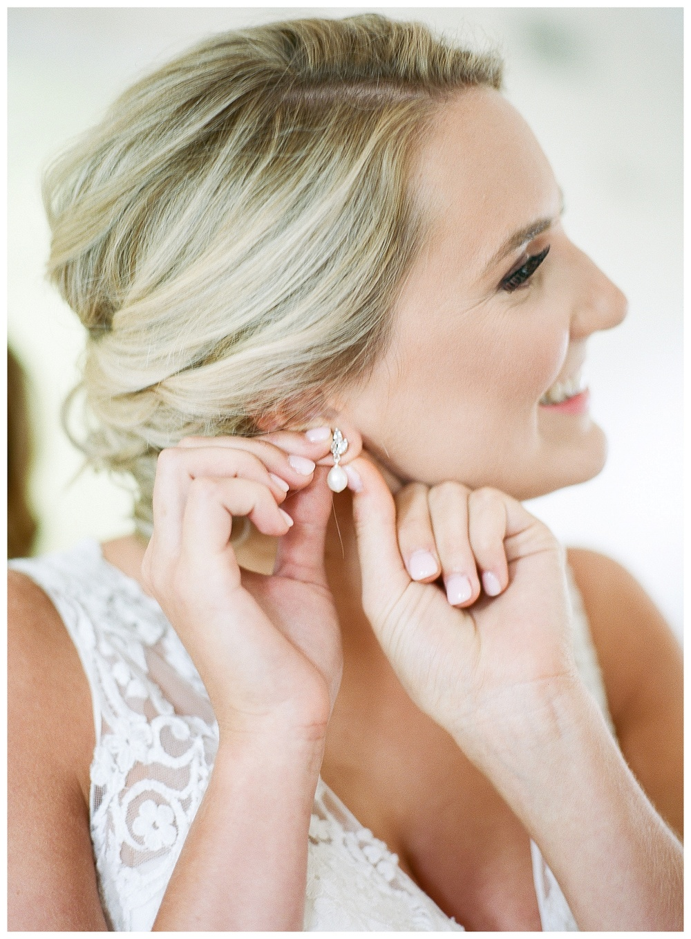 bride puts in her earrings