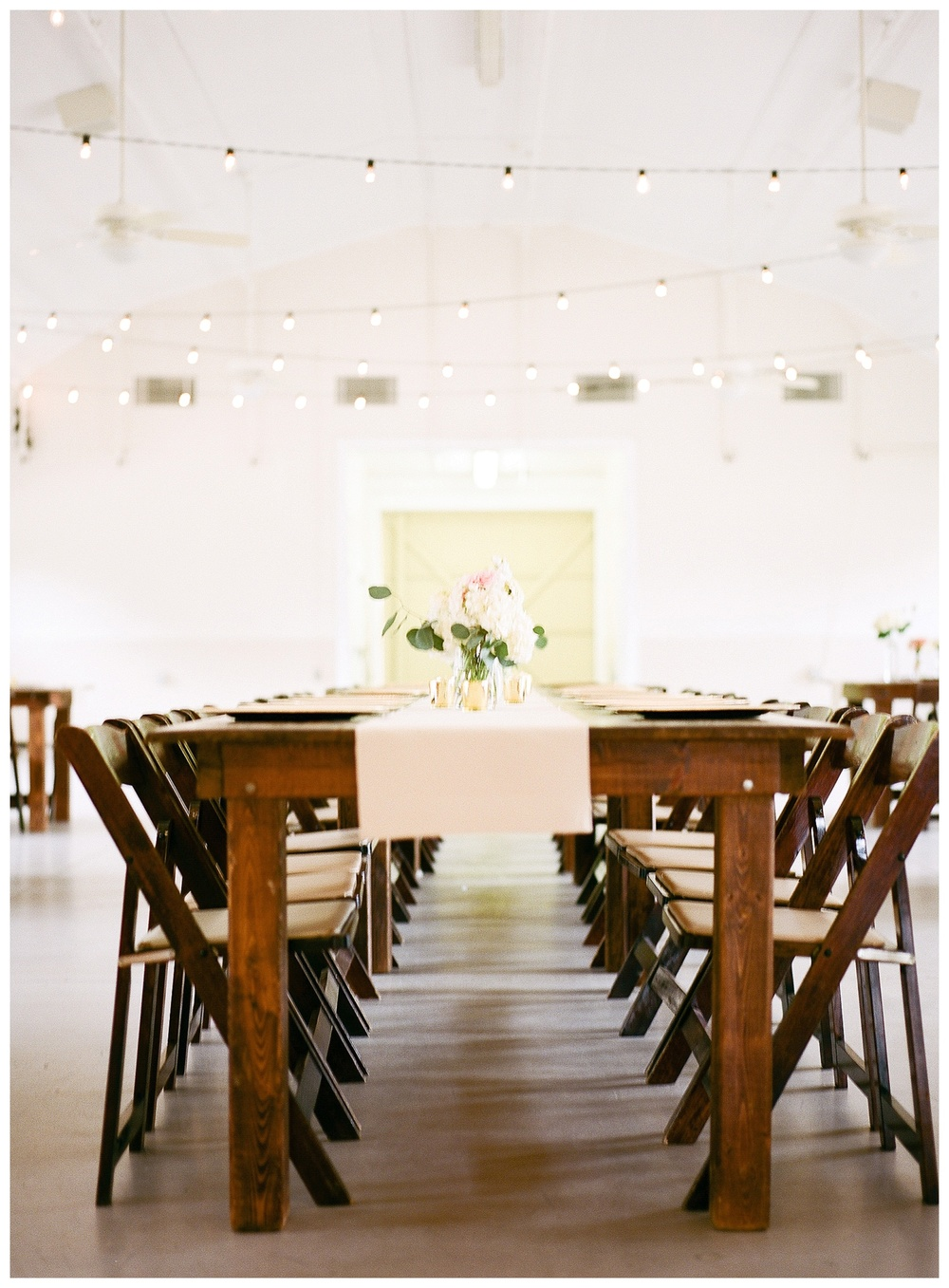 farm house table at bright Dairy Barn Reception