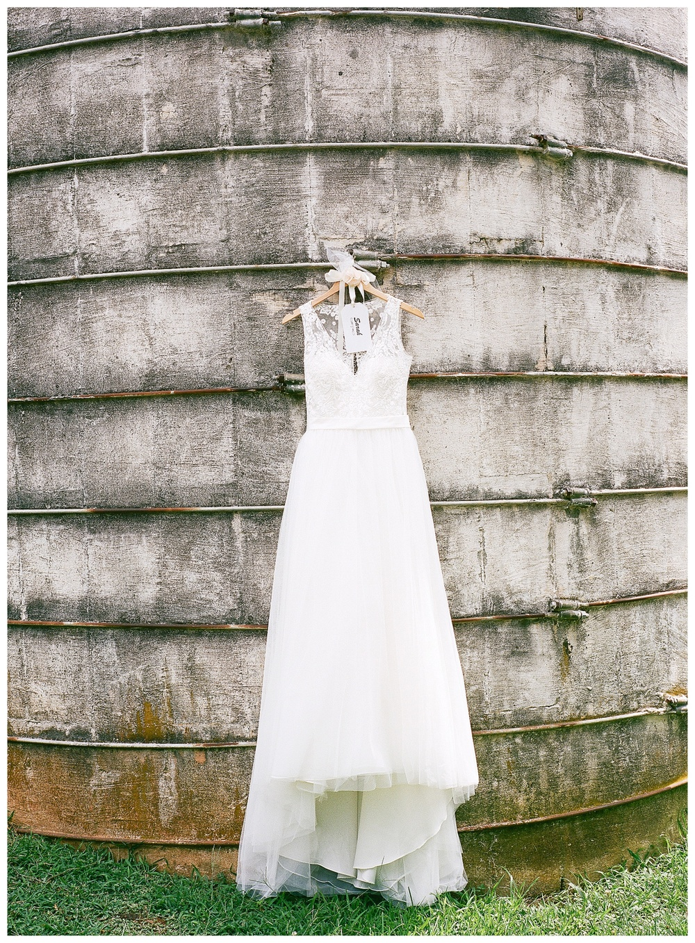 Wedding Dress hanging on silo
