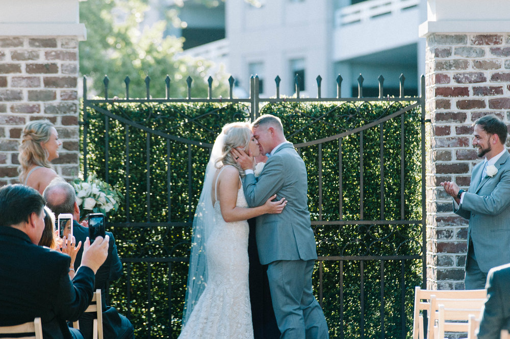 couple's first kiss at wedding ceremony at Gadsden House Wedding, Charleston, SC