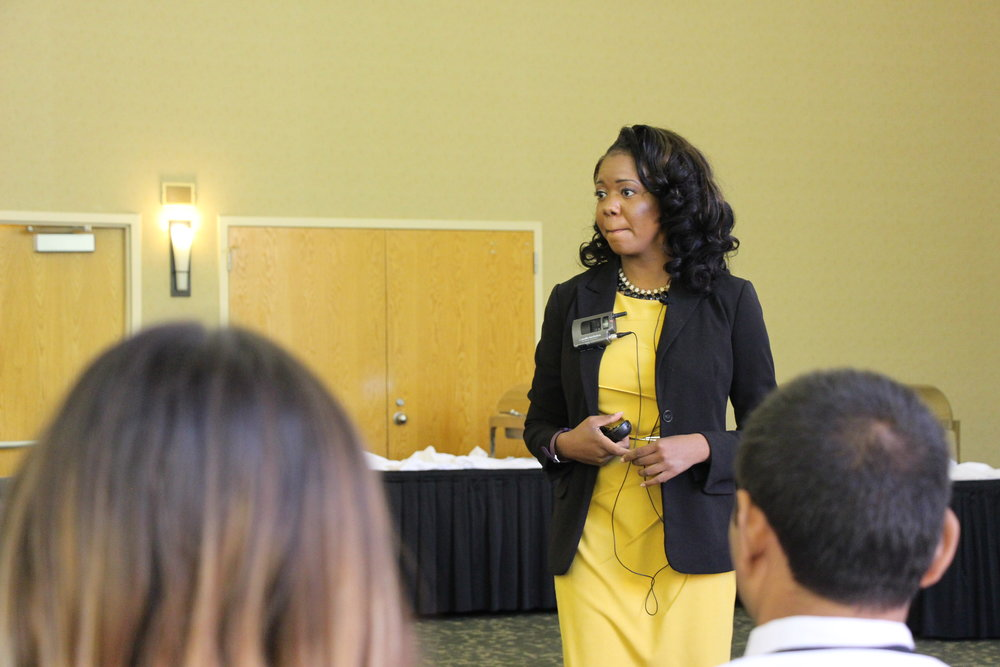 Charlene mouth together looking at audience WMU Womens Leadership Conference.JPG