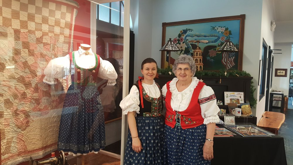 Ivana Miculka of Valasske Mezirici, Moravia, Czech Republic and Lydia Faust, Snook, Texas, USA model Czech Kroj at the Czech Heritage Museum in Temple, Texas.