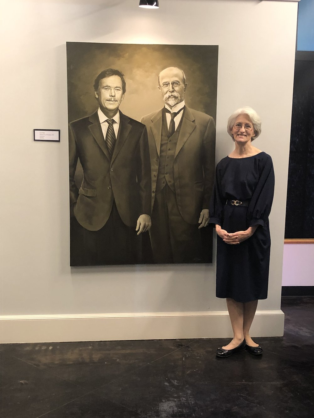 Artist Lisa Chase with her painting,  Visionaries of Freedom  at the Czech Heritage Museum in Temple, Texas.