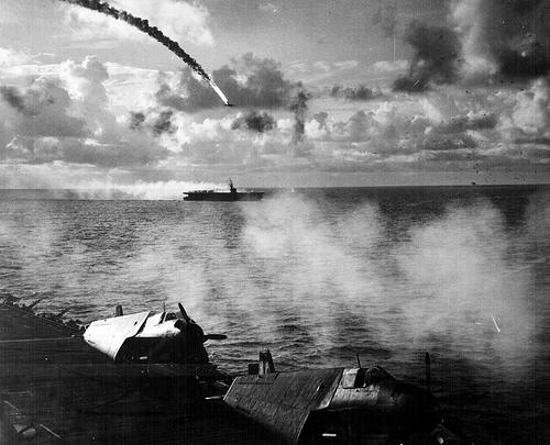 A Japanese plane goes down in the distance during Operation Forager. Image courtesy of cmchant.com