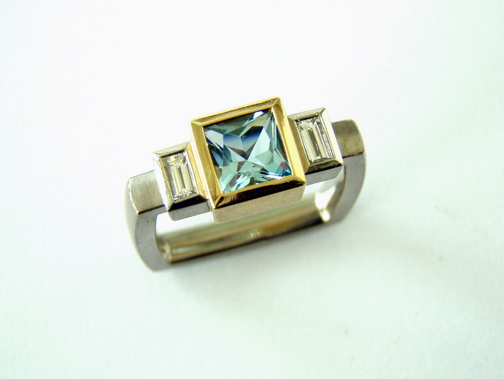 18ct white and yellow square engagement ring set with large princess cut aquamarine and two baguette diamonds