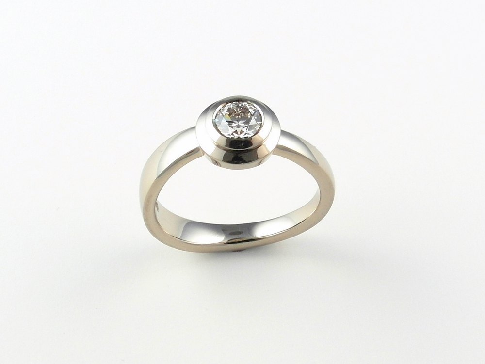 18ct white gold engagement ring set with a very high quality 0.56ct brilliant cut diamond