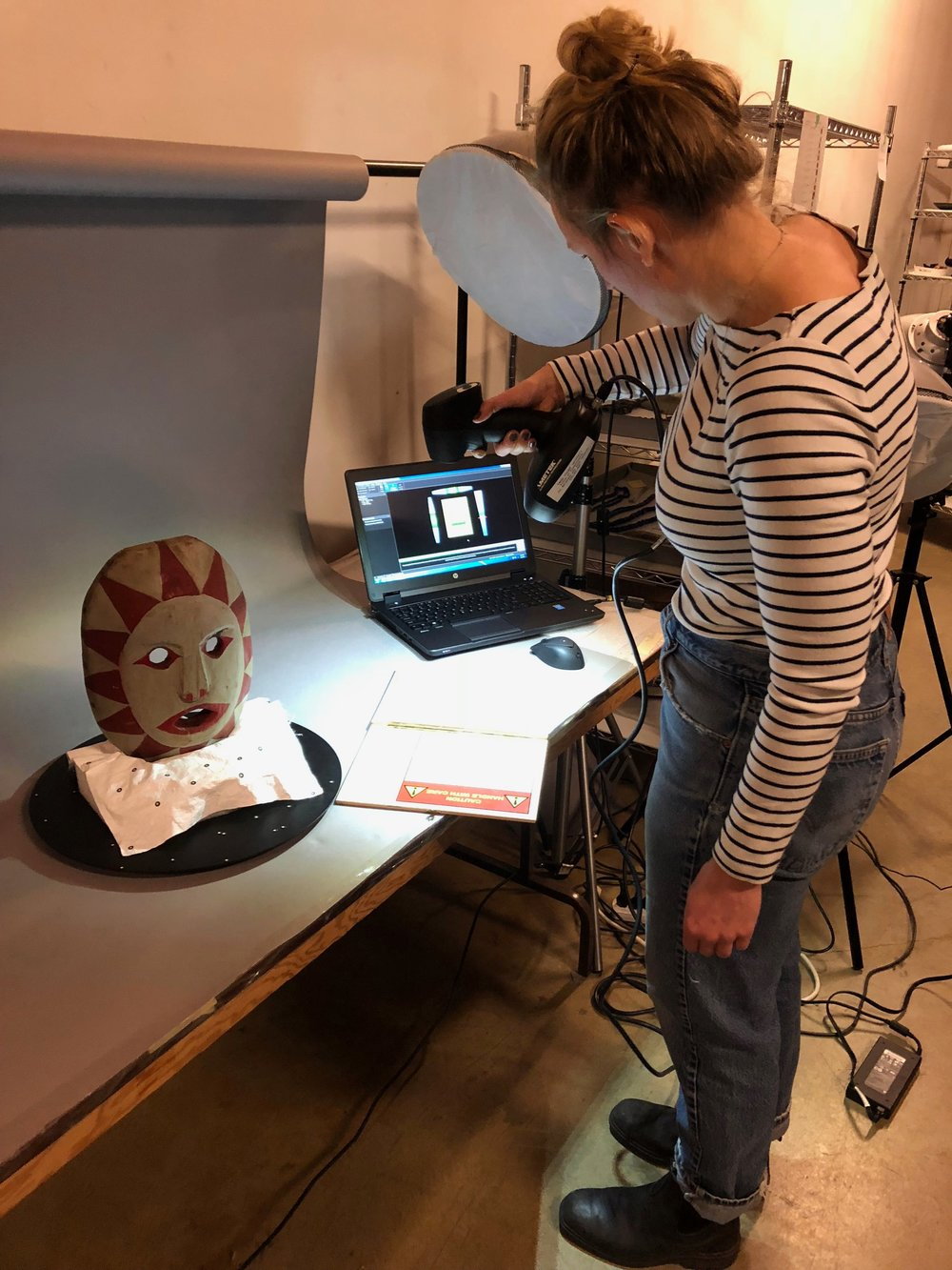 Hannah Turner PHD, wielding the Creaform 3D scanner during our 3rd Upgright scan of the object.