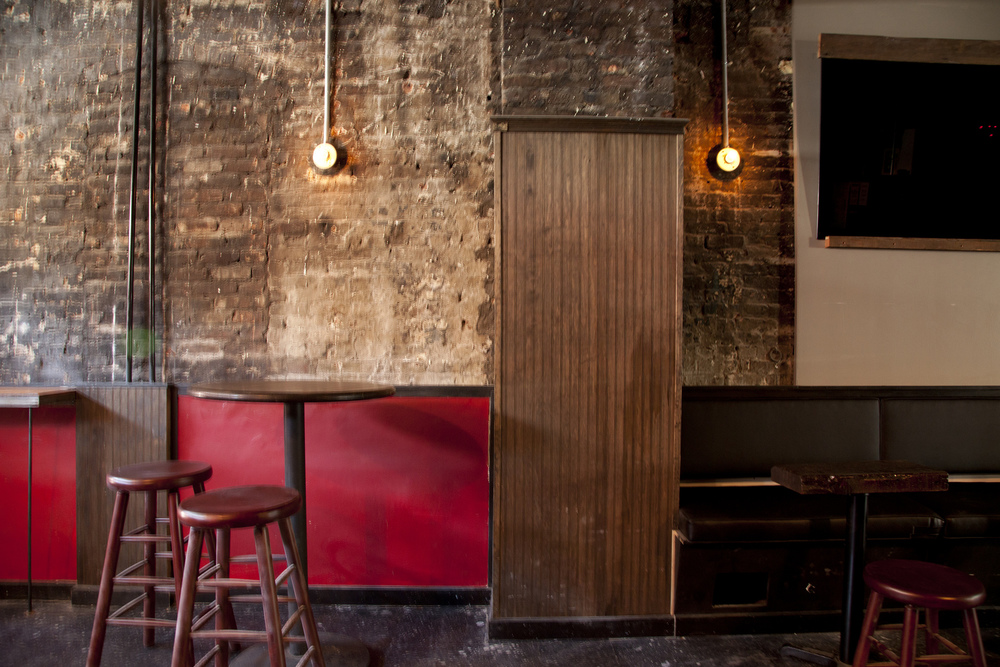 opposite the bar