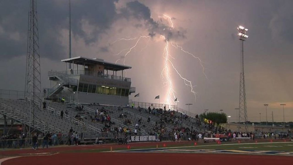 Lightning strikes near a high school football game in Texas