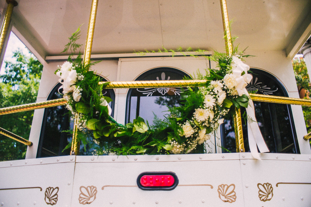 Mobile Alabama wedding trolley with a white rose garland