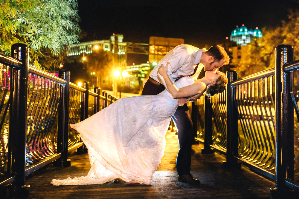 downtown Orlando romantic night wedding kiss bridge streetlights city