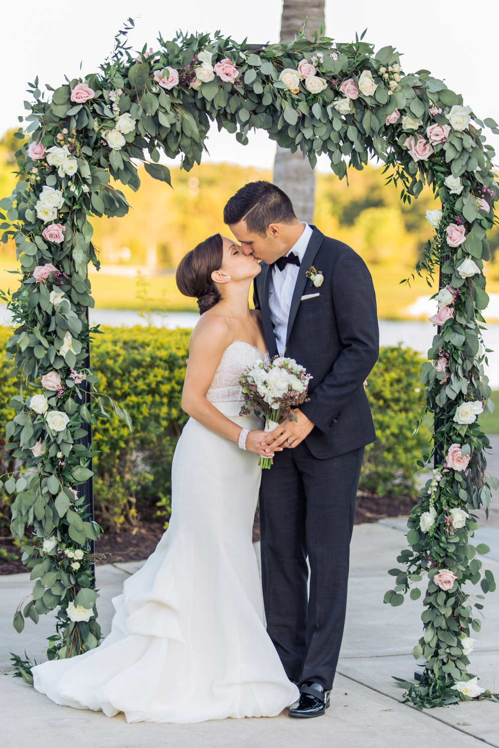 Floral wedding arch & bridal bouquet by In Bloom Florist // Rosen Shingle Creek, Orlando, Florida
