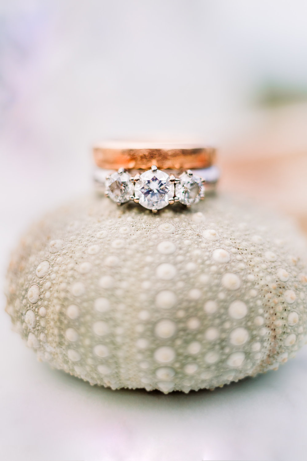 Diamond trio wedding ring and rose gold band with sea urchin at a destination wedding at the Port Molyneux School