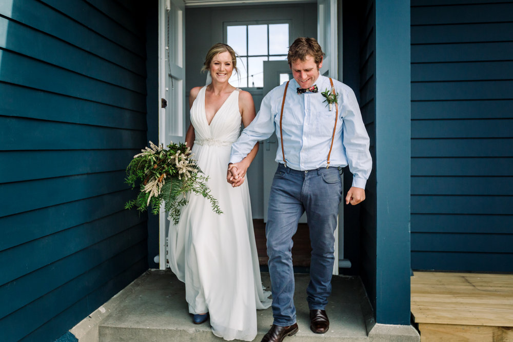 Modern natural bride & groom at a destination wedding at the Port Molyneux School