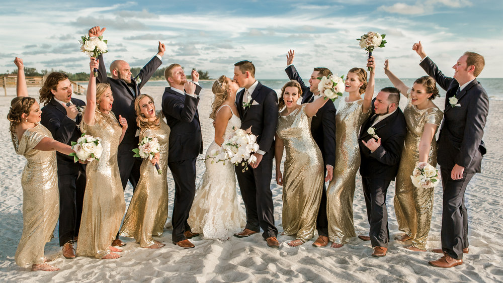 Longboat Key Club wedding party of bridesmaids in gold sequin mermaid dresses and orchid and white rose bouquets by Victoria Blooms and groomsmen in black tie suits by Hugo Boss