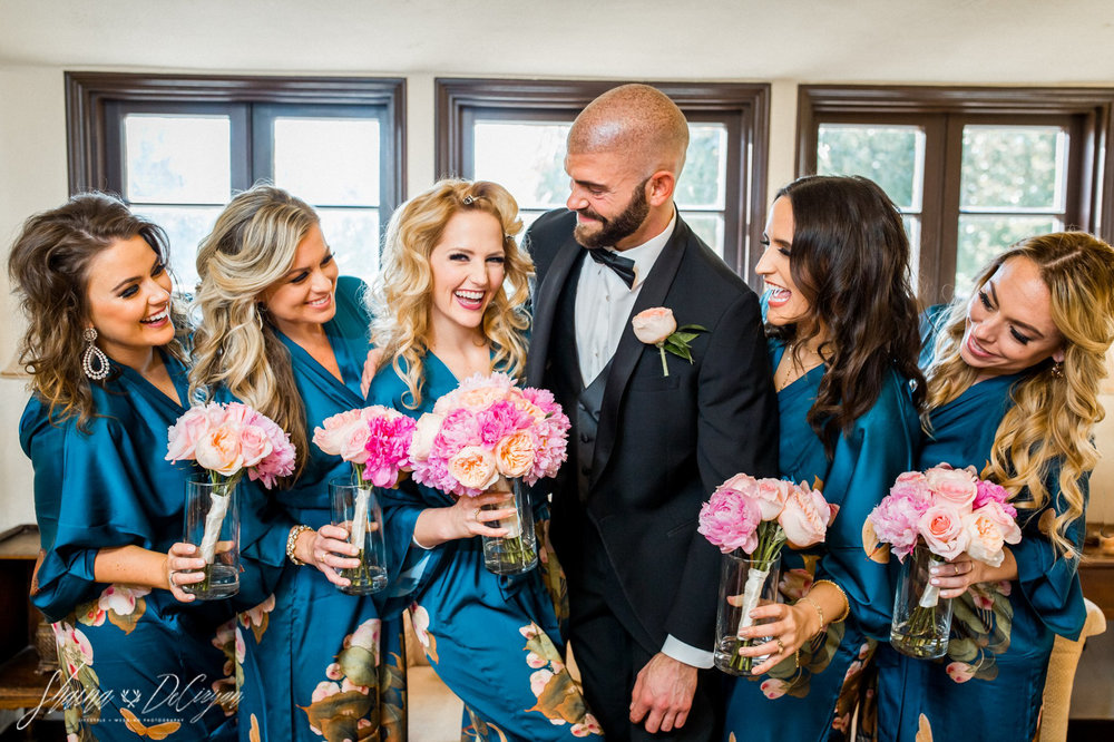 Bridesmaid + Groomsmaid party with their pink peony bouquets