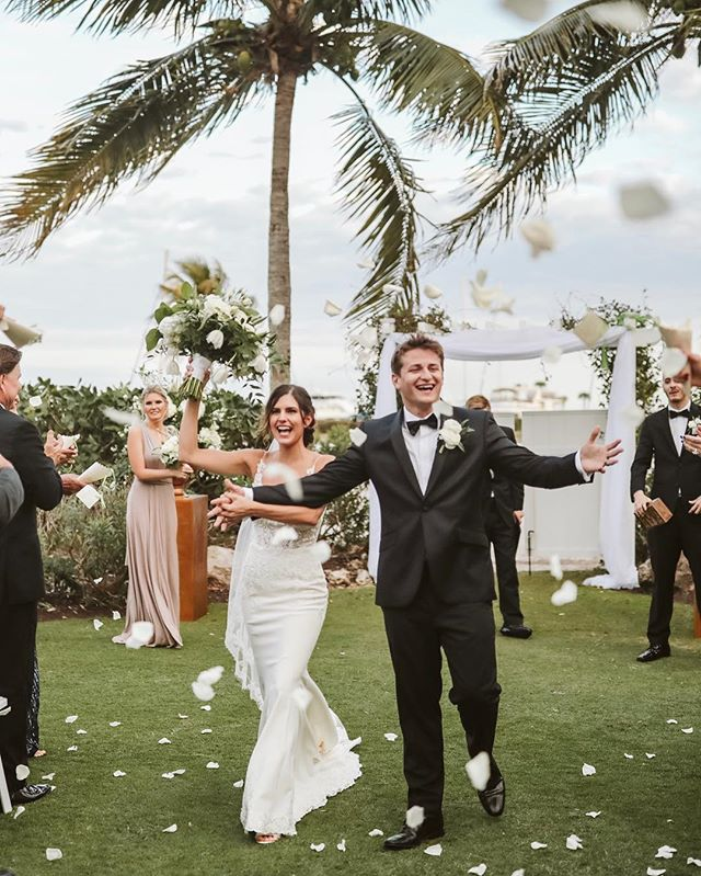 They just said yes to forever! Congrats to this freshly married husband and wife duo! 🌿 . . . . #longboatkeywedding #weddingstyle #rosepetaltoss #walkdowntheaisle #2019wedding #shainadeciryanphotography #swankysoiree #sarasotaweddingphotographer #travelweddingphotographer #seattleweddingphotographer #orlandoweddingphotographer #yesessense