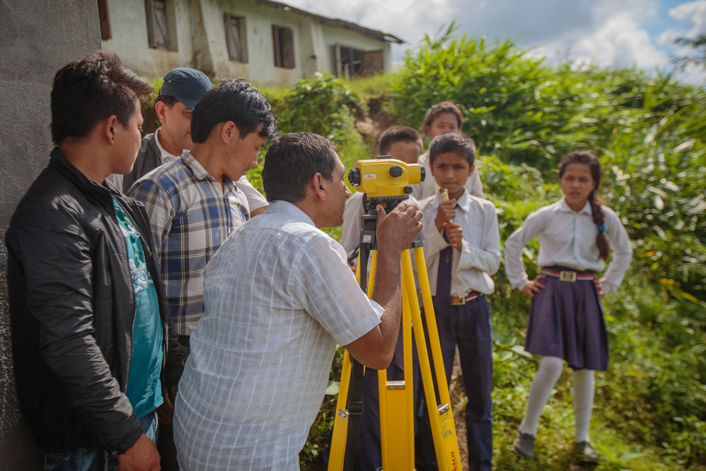 Surveying with our local partners for a spring source project at a school in Godak, a rural community about an hour from Ilam, Nepal.