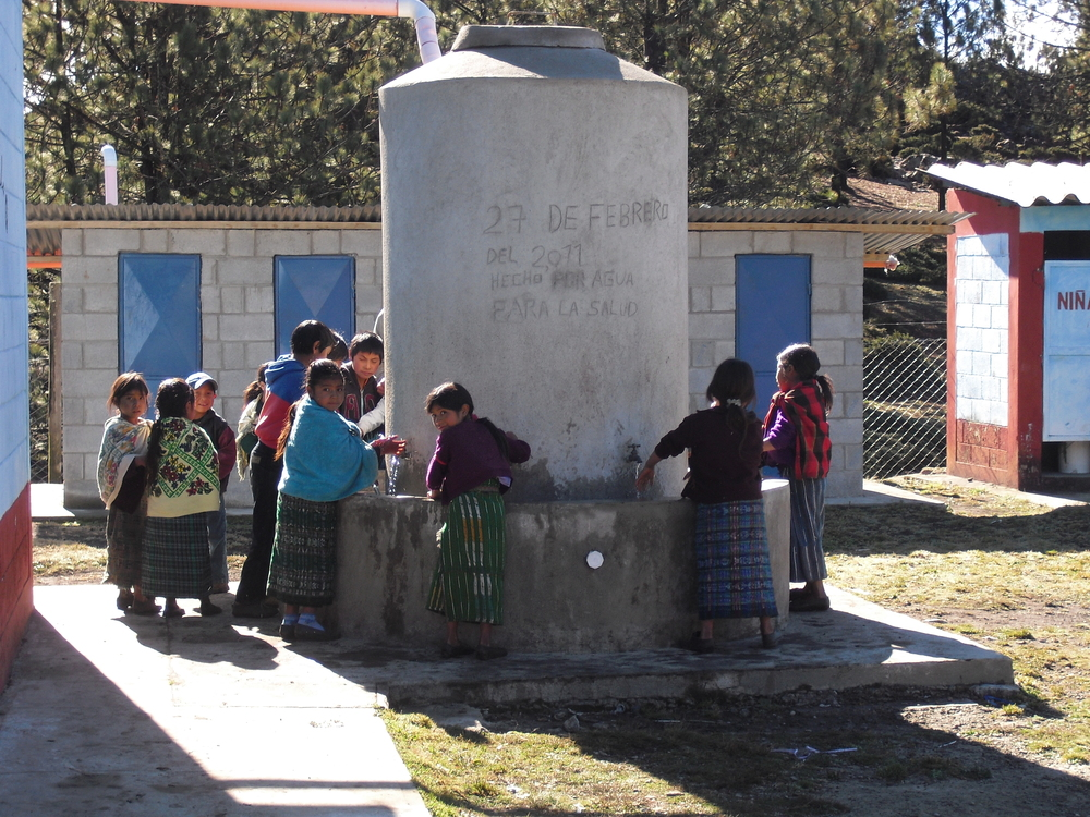 Village children at their local school in the Ixil region using a hand washing station recently constructed by a previous ACCMARI project.