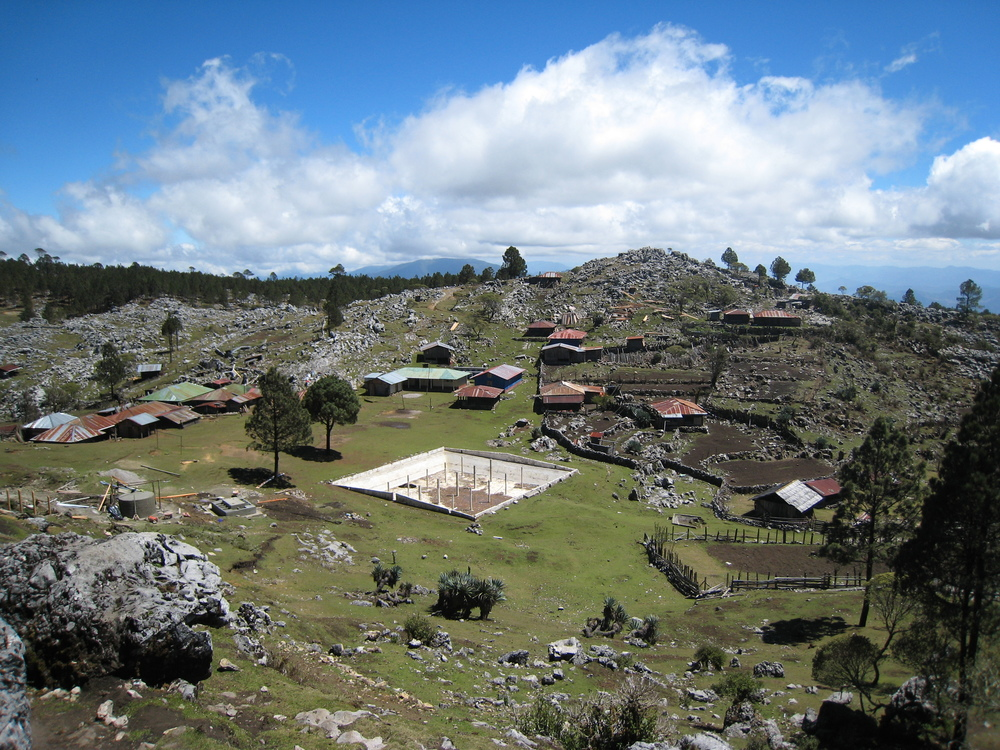 A village in the Ixil region, with a dilapidated water holding tank.