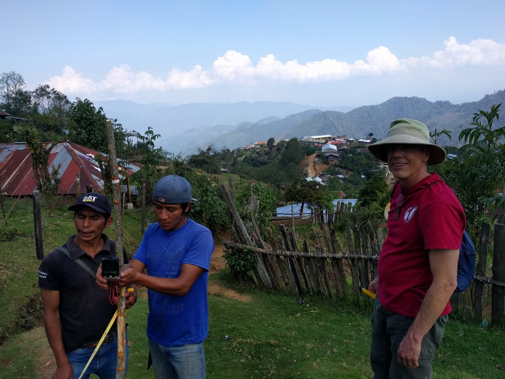 RMP member Jeff Hargis supervising two community member as they helped us survey the distribution lines.