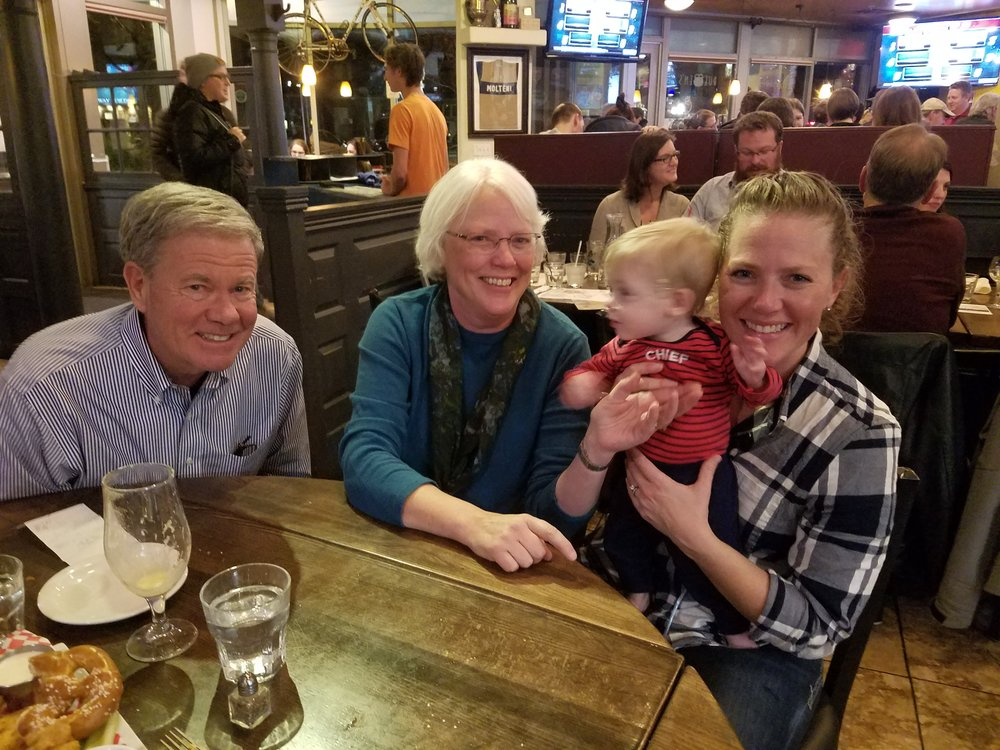 Upcoming President of EWB-USA Board of Directors Joe Adams (first from left) with his family, including grandson Finn.