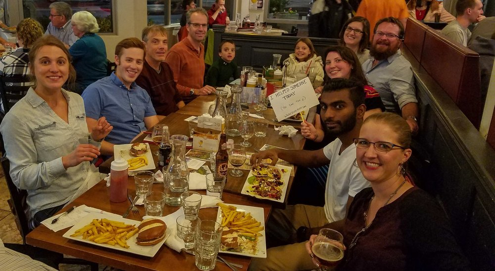 Our EWB-RMP table with many of our chapter members gathered together for dinner.