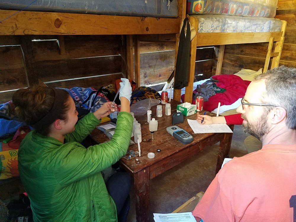Nicki and Dave performing water tests in our cabin