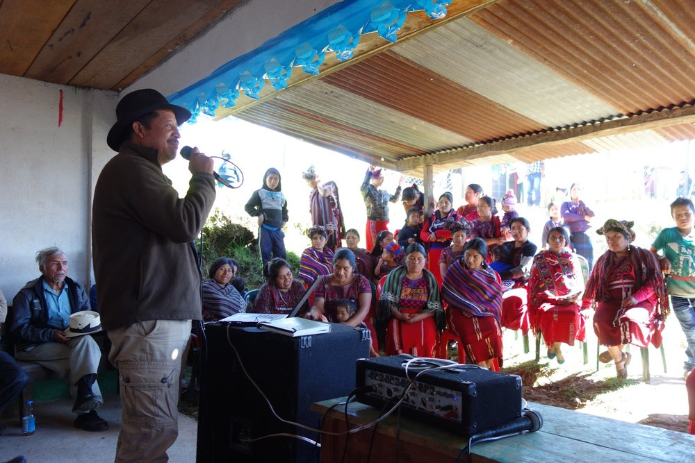 Diego speaking to the community at the town meeting before lunch.