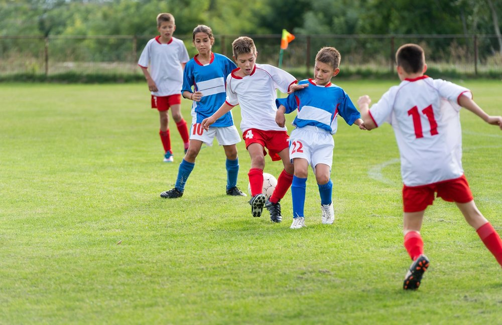 22428788_L_Kids_playing_Soccer_Sports_Children_Team_Ball_field.jpg