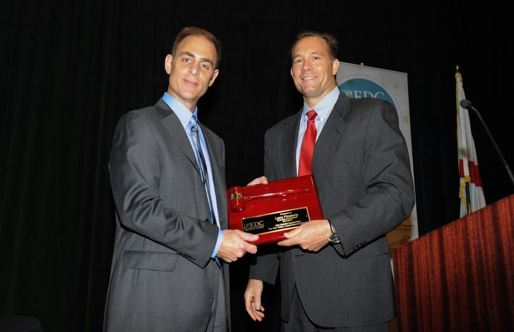 Larry Fineberg (left) of Benderson Development hands off the gavel to incoming EDC Chairman of the Board, Pat Dorsey (right) of the Herald Tribune