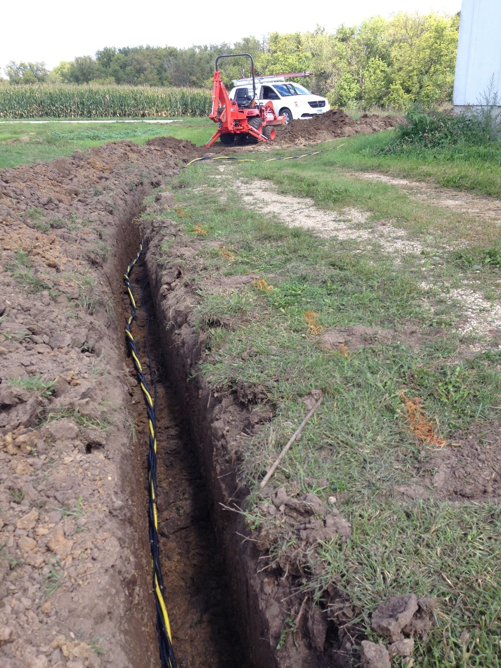 Electric cable laying in a trench.
