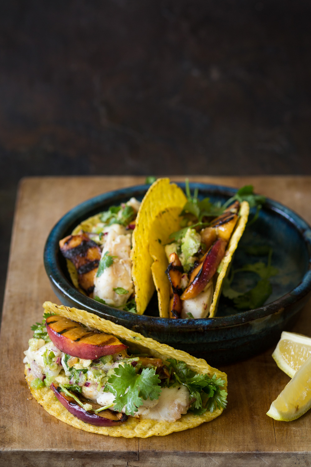 Fish and grilled nectarine tacos