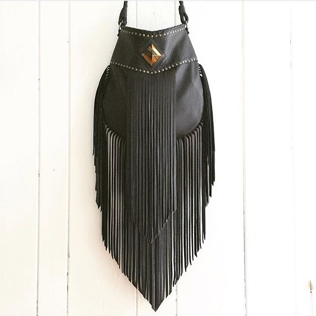 The Aurora fringe bag. So much care and detail goes into every aspect of this beauty. Available in the shop! #nativerainbow #handcraftedintheusa #leatherbag #fringebag #etsy #leatherworker #craftedwithlove